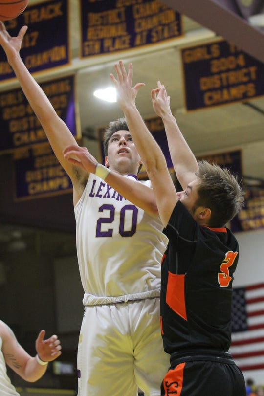 Lexington's Max Waldruff goes up for two of his game-high 16 points in Tuesday's 47-32 Ohio Cardinal Conference victory over Mount Vernon.