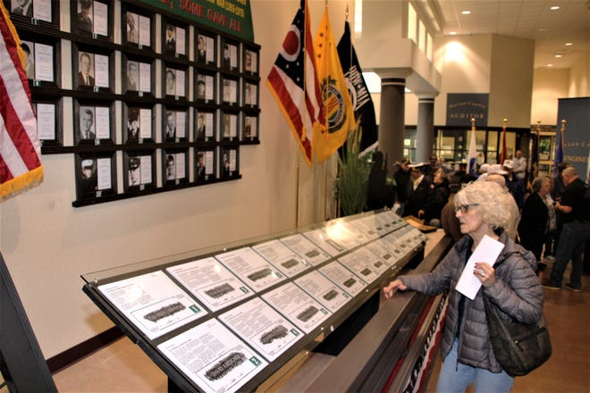 A memorial wall honoring the 26 Marion County men who lost their lives during the Vietnam War was officially dedicated on Tuesday at the Marion County Building in downtown Marion. The idea for local memorial was inspired by The Wall That Heals, a traveling replica of the Vietnam Veterans Memorial in Washington, D.C. The Wall That Heals made a stop last summer in Marion County.