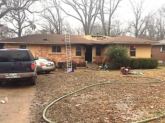 One adult female and a family dog were found dead after a fire at 1604 Wilson Rd. on Tuesday. Authorities determined the cause as accidental and candle-related.
