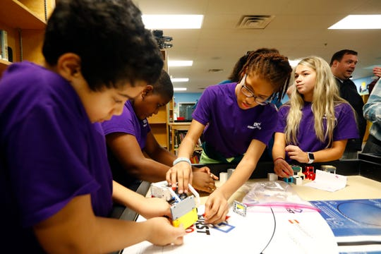 Robotics lab students Aiden Bosanto, 11, from left, Jeremiah Coleman, 11, M'Kaila Hill, 12, and Lauren Allen, 11, demonstrate the skills test navigated by their robot, named Kermit, for the Lego robotics team, one of eight that have qualified for regionals from Barret's Chapel in Arlington on Wednesday, Jan. 15, 2020.