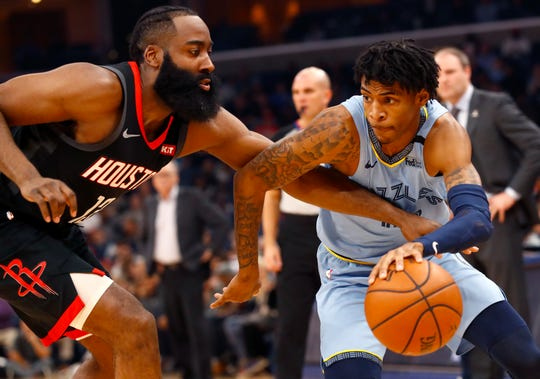 Memphis Grizzlies guard Ja Morant drives past Houston Rockets guard James Harden during their game at the FedExForum on Tuesday, Jan. 14, 2020.