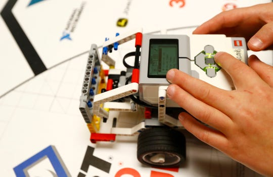Robotics lab student Lavin, 12, demonstrates the skills test navigated by their robot, named Kermit, for the LEGO robotics team, one of eight that have qualified for regionals from Barret's Chapel in Arlington on Wednesday, Jan. 15, 2020.