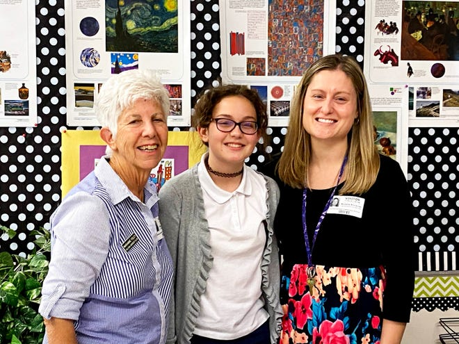 Marianne Foley, scholarship chair of Calusa Garden Club, Kyleigh Haueter and Kyleigh's mother, Michelle Kilickiran.