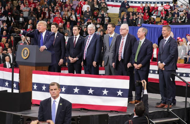 President Donald Trump introduces a group of Wisconsin Republican politicians as he speaks at the UW-Milwaukee Panther Arena where the president held a campaign rally in Milwaukee on Tuesday, Jan. 14, 2020.