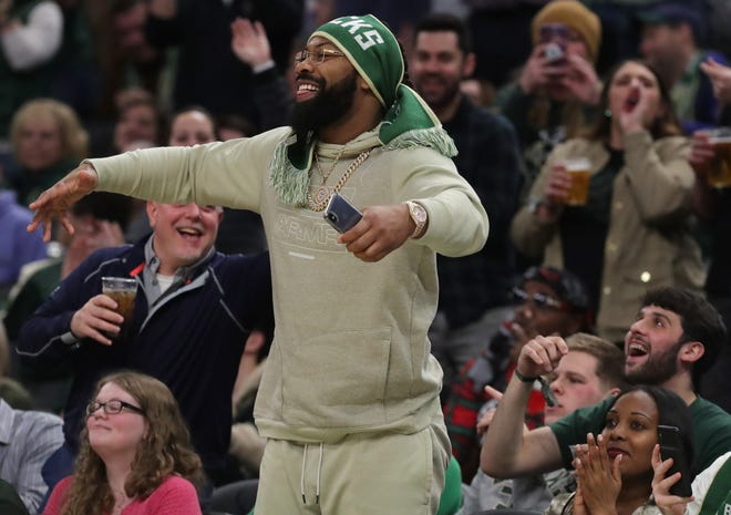 Green Bay Packers linebacker Za'Darius Smith stands up after being introduced to the crowd at Fiserv Forum during the second half of the Bucks' game against the Knicks on Tuesday night.
