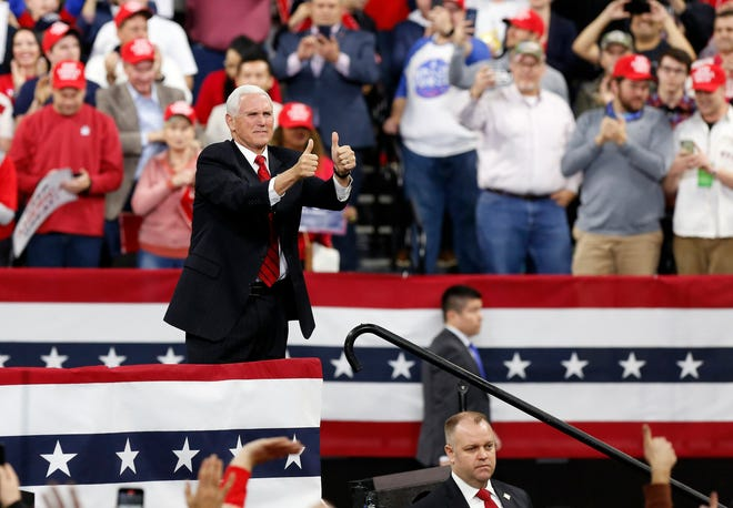 Vice President Mike Pence gives the thumbs up as he speaks at a rally held by U.S President Donald Trump on Jan. 14 at UW-Milwaukee Panther Arena.