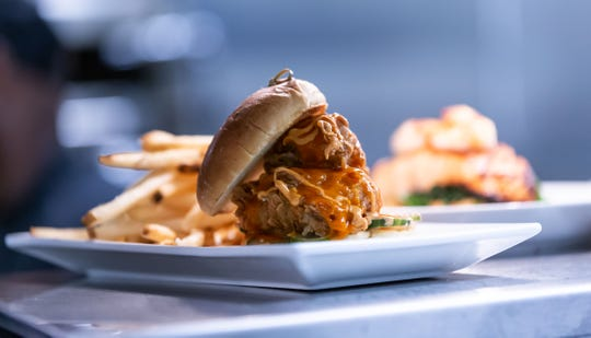 The Hot Bird, a fried-chicken sandwich with Buffalo sauce and pickles, stands among the best chicken sandwiches in Milwaukee. It's on the menu at Silverspot Cinema in Brookfield.