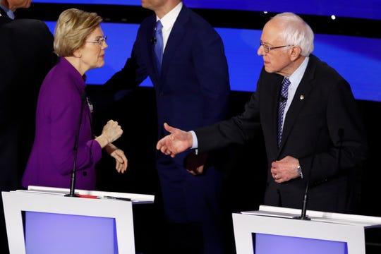 Democratic presidential candidate Sen. Elizabeth Warren and Sen. Bernie Sanders talk Tuesday, Jan. 14, 2020, after a Democratic presidential primary debate hosted by CNN and the Des Moines Register in Des Moines, Iowa.