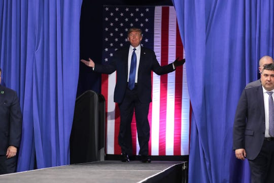 President Donald Trump acknowledges the crowd before he speaks at the UW-Milwaukee Panther Arena on Tuesday.