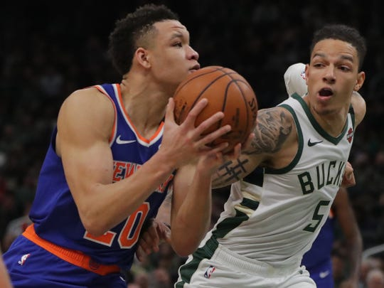Bucks forward D.J. Wilson  tries to slow down Knicks forward Kevin Knox.
