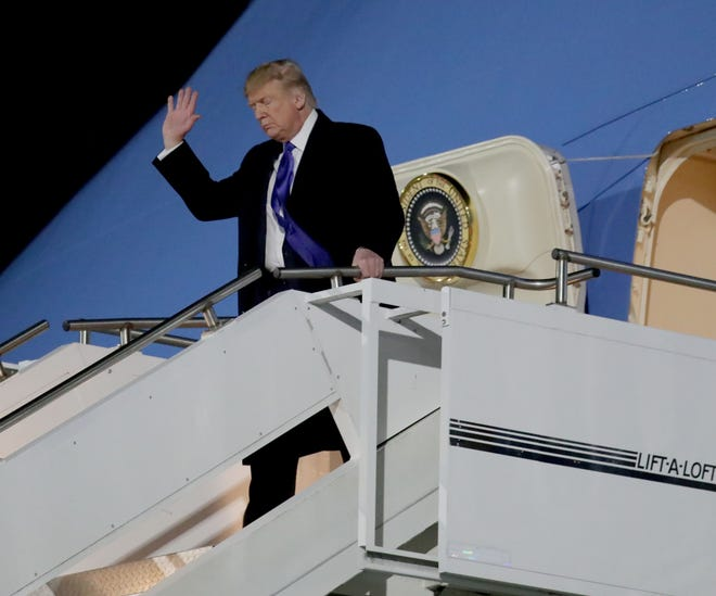 President Donald Trump arrives at the 128th Air Refueling Wing at Milwaukee Mitchell International Airport on Air Force One before heading to the UW-Milwaukee Panther Arena for a campaign rally in January.