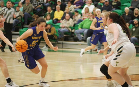 Mountain Home's Kate Gilbert drives the lane against Greene County Tech on Tuesday night.