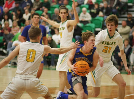 Mountain Home's Wyatt Gilbert drives the lane against Greene County Tech on Tuesday night.