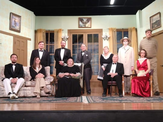 The cast of And Then There Were None includes (seated, left to right) Brenndon Calhoun, Skylar Jensen, Dianne Paknau, Bill Simpson, Olivia Wolfe, (standing, left to right) Mike Horberg, Michael Reich, Clark Middleton, Patty Kotlicky, Cameron Adkins, and Craig Perry.