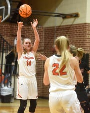 Viola's Lindsey Browning (14) passes to teammate Keyaira Moore during the Lady Longhorns' 62-38 victory over Calico Rock on Tuesday night.