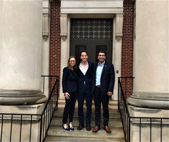 Harvard fellows Katie Shultz, Andrew Bentley and Simon Borumand on the steps at City Hall