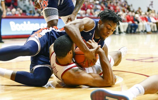 Auburn center Anfernee McLemore (24) and Alabama forward Galin Smith (30) fight for a loose ball on March 5, 2019, in Tuscaloosa, AL.