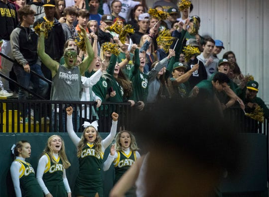 Edgewood fans cheer on their team at Edgewood Academy in Elmore, Ala., on Tuesday, Jan. 14, 2020.