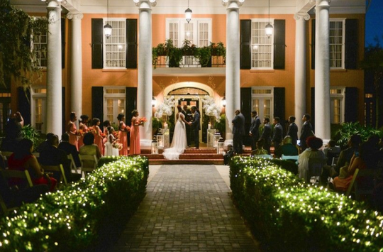 An African American wedding party at Southern Oaks Plantation in New Orleans, Louisiana.