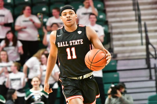 Ball State redshirt freshman guard Jarron Coleman dribbles the ball during the Cardinals' game against Eastern Michigan.
