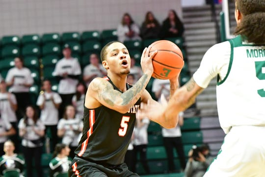 Ball State junior guard Ishmael El-Amin competes during the Cardinals' game against Eastern Michigan.
