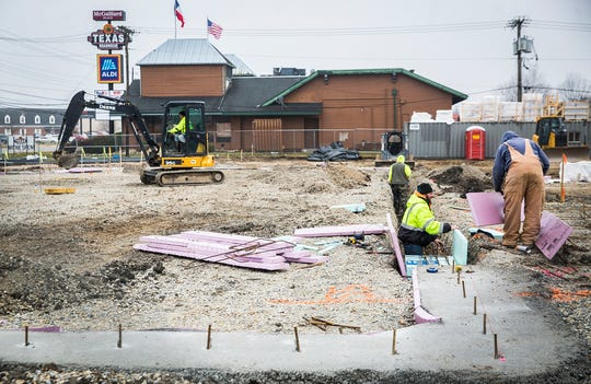 Work continues at the former site of ALDI's on McGalliard Road where a new Texas Roadhouse restaurant will be constructed.