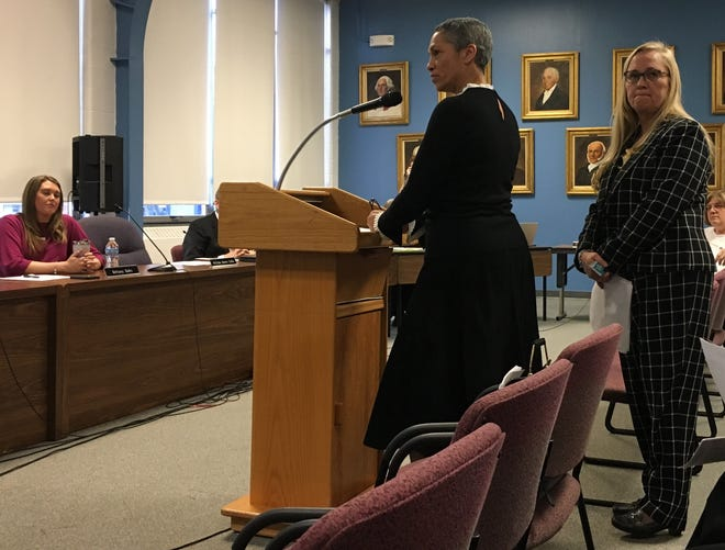 Meridian Health Services officials Tracy Douglas-Wheeler, center, and Lisa Suttle address the Muncie Community School Board, including member Brittany Bales, left on Tuesday, Jan. 14.