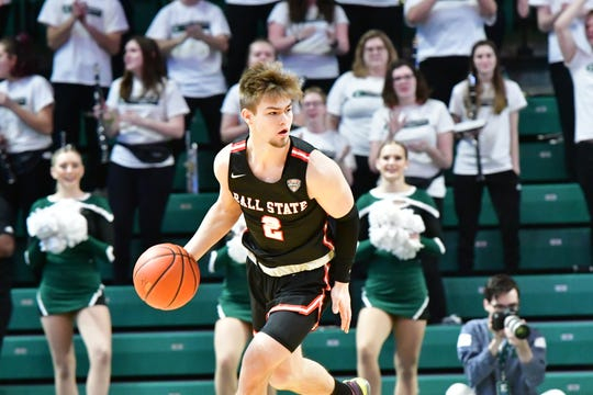 FILE -- Ball State freshman guard Luke Bumbalough dribbles the ball during the Cardinals' game against Eastern Michigan on Jan. 14, 2020.