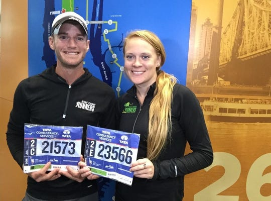 Justin Moomaw and Holly Kistler show their numbers before running the New York City Marathon together in 2016. After meeting through running, both have qualified for the 2021 Boston Marathon and both are board members of local group Gulf Coast Runners, which puts on the Naples Daily News Half Marathon.
