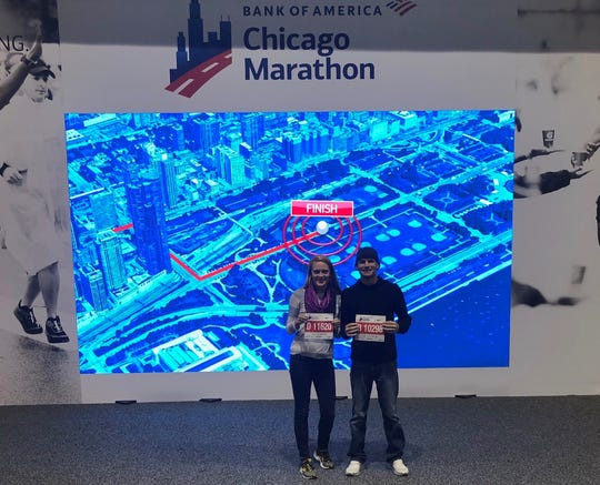 Naples residents Holly Kistler and Justin Moomaw show off their race numbers from the Chicago Marathon in October 2019. Kistler and Moomaw, who are board members of Gulf Coast Runners, both set personal bests at the event and qualified for the 2021 Boston Marathon.
