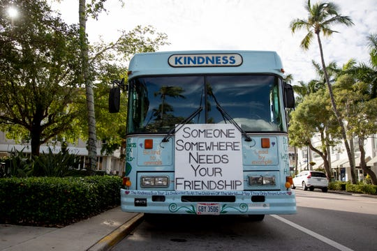 Messages of kindness cover Bob Votruba's bus, parked on Fifth Avenue South in Naples on Tuesday, January 14, 2020. Votruba has been traveling around the country and spreading messages of kindness since the mass shooting at Virginia Tech.