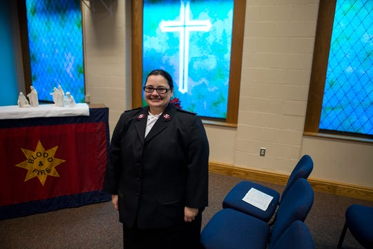 Newark Salvation Army Captain Kaitlyn Haddix poses for a photo in the sanctuary of the Salvation Army in Newark.