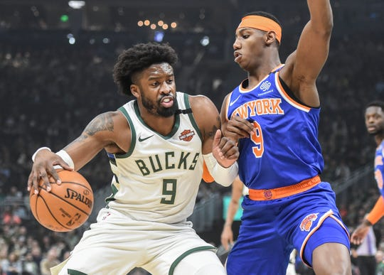 Jan 14, 2020; Milwaukee, Wisconsin, USA;  Milwaukee Bucks guard Wesley Matthews (9) drives for the basket against New York Knicks guard RJ Barrett (9) in the first quarter at Fiserv Forum.