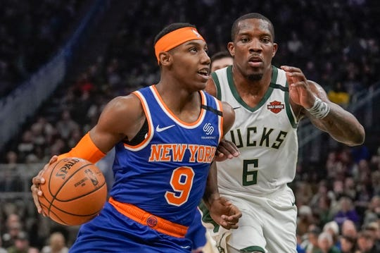 New York Knicks' RJ Barrett drives past Milwaukee Bucks' Eric Bledsoe during the first half of an NBA basketball game Tuesday, Jan. 14, 2020, in Milwaukee.
