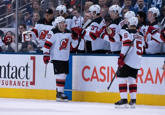Jan 14, 2020; Toronto, Ontario, CAN; New Jersey Devils center Blake Coleman (20) celebrates at the bench after scoring a goal during the second period against the Toronto Maple Leafs at Scotiabank Arena.