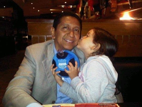 A six-year old Amy Rodriguez kisses her father Douglas Miguel Rodriguez Barzola.  All photos are courtesy of Martha Freire.