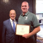 Outgoing DePaul athletic director Joe Lennon, left, with Spartans head football coach (and future AD) John McKenna.
