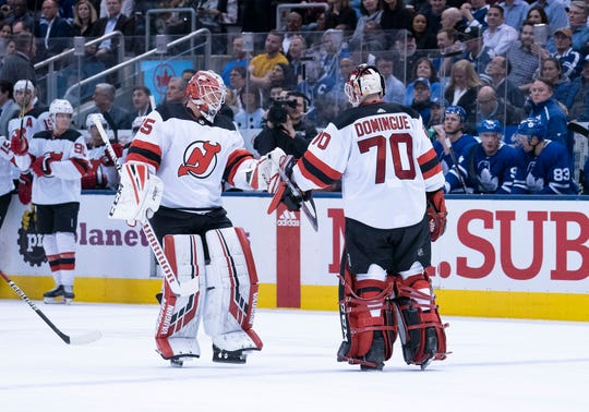 Jan 14, 2020; Toronto, Ontario, CAN; New Jersey Devils goaltender Louis Domingue (70) is replaced by New Jersey Devils goaltender Cory Schneider (35) during the second period against the Toronto Maple Leafs at Scotiabank Arena.