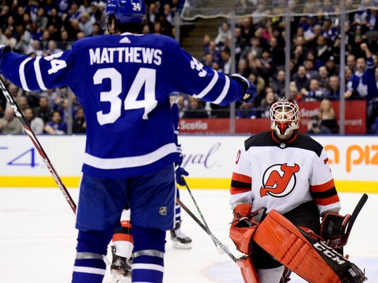 New Jersey Devils goaltender Louis Domingue (70) reacts after giving up a goal to Toronto Maple Leafs center Auston Matthews (34) during the second period of an NHL hockey game Tuesday, Jan. 14, 2020, in Toronto.