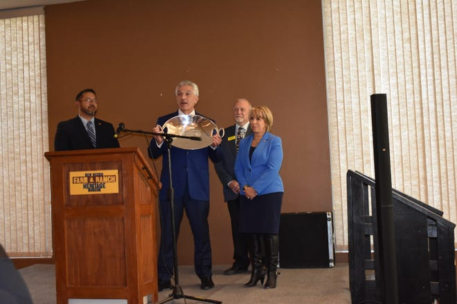 Roundhouse 2020 Forecast legislative luncheon hosted by all three local chambers, presented New Mexico Governor Michelle Lujan Grisham with a token of appreciation for her support at last year's legislative session.