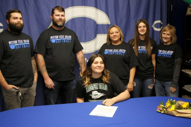 Carlsbad senior Taighen Whitzel signs her letter of intent to play softball at Western Texas College next season. Whitzel batted .441 and helped lead Carlsbad to the 5A championship game last season.