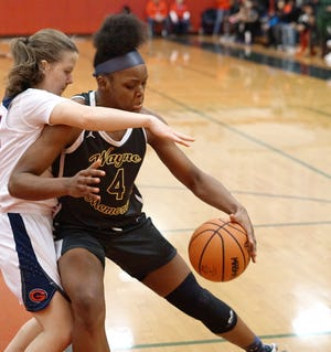 Wayne Memorial Zebra Alanna Micheaux backs down her John Glenn defender.