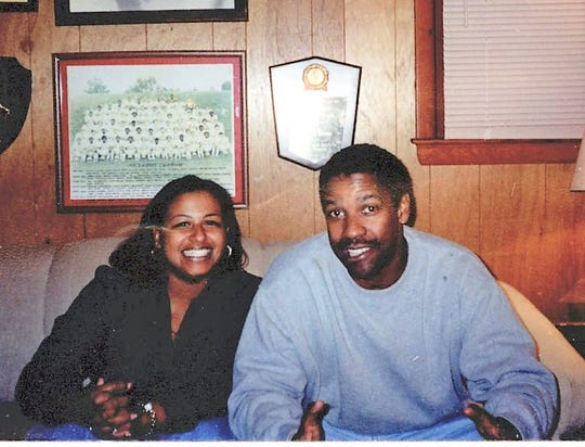 """Monica Merritt and her family members still keep in touch with Denzel Washington, who she first met in 2000 while he was portraying her dad in """"Remember the Titans""""."""