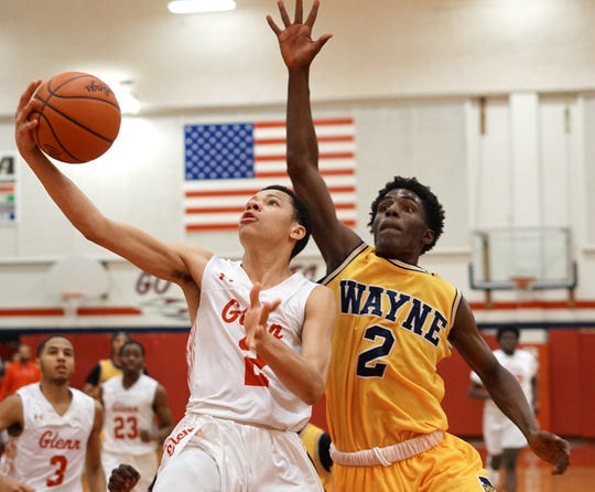 Sharieff Lidell, left, goes in for a layup guarded by Wayne's Tyler Smith-Whitlock.