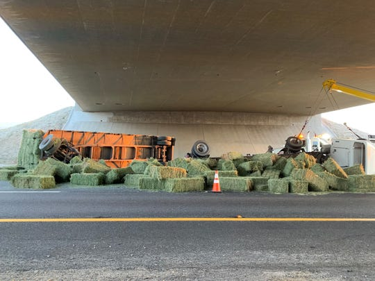 Hay bales block two lanes on westbound Interstate 10 at Cook Street Wednesday, Jan. 15, 2020. A big right crashed and traffic was delayed for several hours. No injuries were reported.