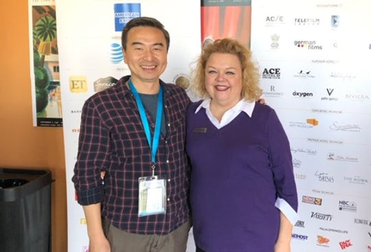 Filmmaker S. Leo Chiang poses with Cortney Weir, regional director of the Alzheimer's Association in the Coachella Valley.