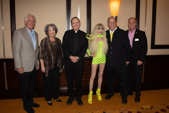Richard Balocco, president and CEO of Desert Arc, joins Nancy Singer, event chair and board member of Desert Arc; Reverend Monsignor Howard A. Lincoln; artists Karen and Tony Barone and Glenn Miller, vice chair of the Desert Arc board of directors and mayor of Indio.
