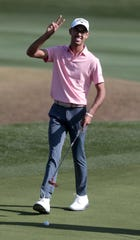 Akshay Bhatia makes a peace sign on the 9th green at The Stadium Course at PGA West in La Quinta, Calif., during The American Express pro-am on Wednesday, January 15, 2020.