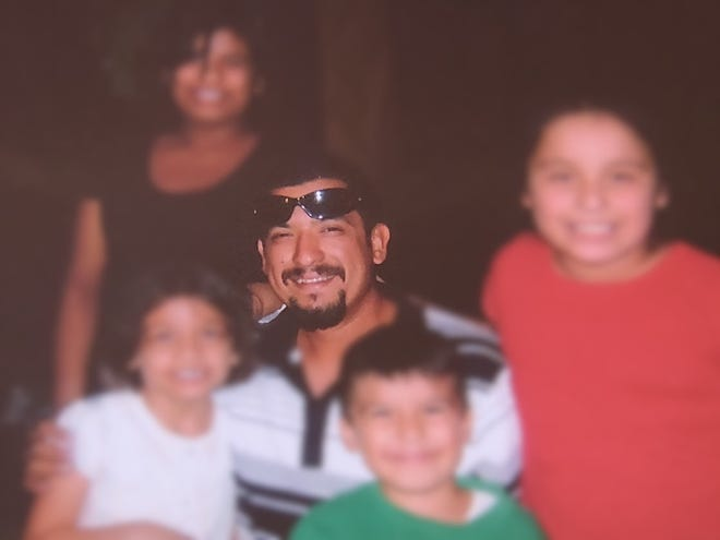 Carlos Chavez Aguirre with four children.