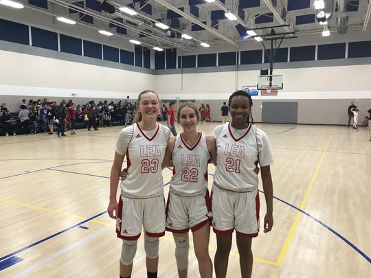 Jan. 2, 2020; Leading Edge Academy girls basketball teammates (L to R) Carlee Smith, Morgan Smith and Brionna Smith take a group photo after winning the Chandler Prep New Years Classic consolation championship over Monument Valley.